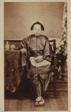 Full length portrait of a Chinese woman, seated.