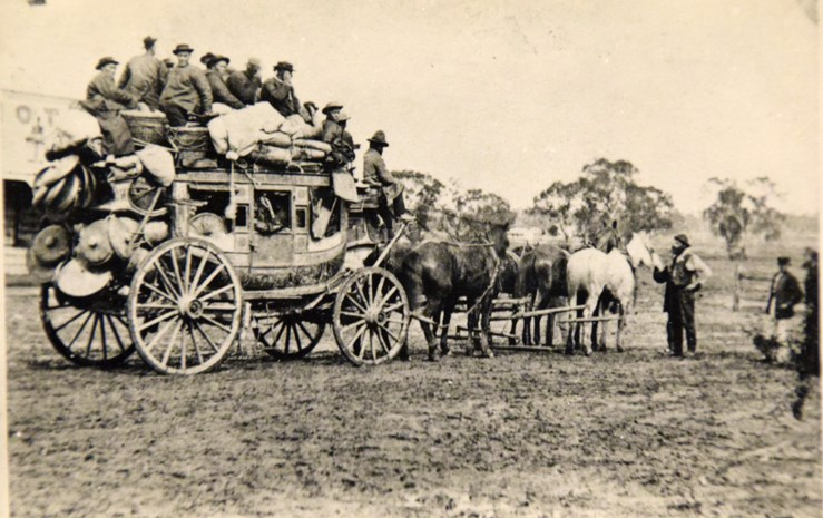 Cobb & Co coach loaded with people (probably from China) and luggage, Newstead, circa 1865-1871.
