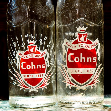 Cohn Bros Cordial Bottles with Badges